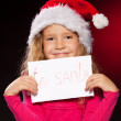 Girl writing a letter to Santa Claus — Stock Photo