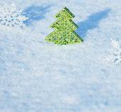 Christmas tree on snow — Stock Photo