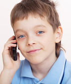 Boy, talking on the phone — Stockfoto