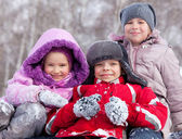 Happy children in winter park — Stock Photo