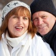 Portrait seniors couple in winter park — Stock Photo