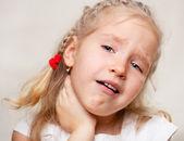 Girl has a sore throat — Stock Photo