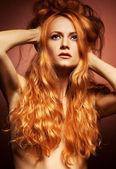 Fashion portrait of sensual redhead young woman — Stock Photo