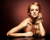 Fashion portrait of sensual young woman on brown background — Stock Photo