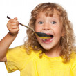 Child with spoon — Stock Photo #15595417
