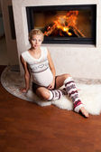 Pregnant woman at home near the fireplace — Stock Photo