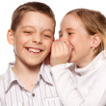 Girl whispers boy in the ear secret — Stock Photo #18476629