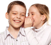 Girl whispers boy in the ear secret — Stock Photo