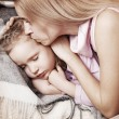 Stok fotoğraf: Parent touching forehead child