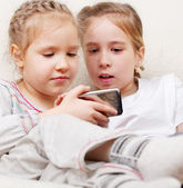 Children with mobile phone — Stock Photo