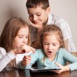 Children playing on tablet — Stock Photo #19278727