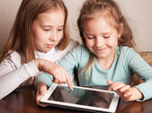 Children playing on tablet — Stock Photo