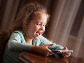 Child playing on tablet — Foto de Stock