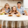 Happy family drinks tea — Stock Photo #20350191