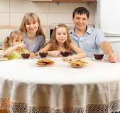 Happy family drinks tea — Stock Photo