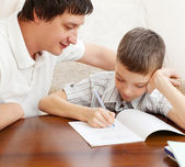 Father helping son do homework — Stock Photo