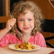 Girl eating potatoes — Stock Photo #21688179