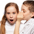 Boy whispers girl in the ear secret — Stock Photo #22838286