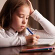 Girl doing homework — Stock Photo #22838304