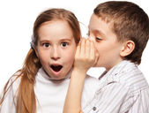 Boy whispers girl in the ear secret — Stock Photo