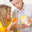 Children with oranges — Stock Photo #24153295