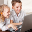 Happy kids playing laptop at home — Stock Photo #24153299