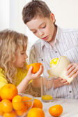 Children with oranges — Stock Photo