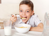 Child eat breakfast — Stock Photo