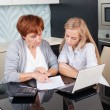 Two women discussing documents at home — Stock Photo