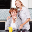 Woman with daughter on kitchen — Stock Photo