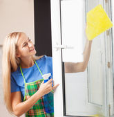 Woman washing window — Stock Photo