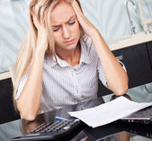 Sad woman looks at the bill — Stock Photo