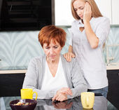 Daughter soothes sad mother — Stock Photo