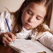 Girl doing homework — ストック写真