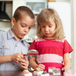 Children are considering magnifying glass collection of stones — Stockfoto #26751583