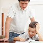 Father helping son do homework — Stock Photo