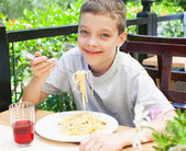 Child eating at cafe — Stock Photo
