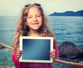 Child with tablet computer — Stock Photo
