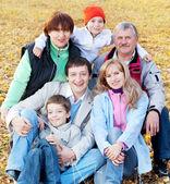 Big family in autumn park — Stock Photo