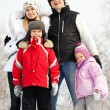 Happy family in winter park — Stock Photo
