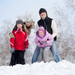 Happy family in winter park — Stock Photo #28109497