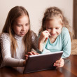 Children playing on tablet — Stok fotoğraf