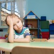 Stock Photo: Sad child in kindergarten