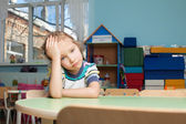 Sad child in kindergarten — Stock Photo