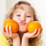 Child with oranges — Stock Photo