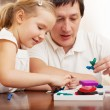 Stock Photo: Girl and dad molded from clay toys