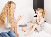 Mother scolding baby — Stock Photo