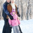 Stock Photo: Family walking in a winter park