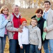 Family in autumn park — Stock Photo
