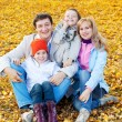 Family in autumn park — Stock Photo #30574453